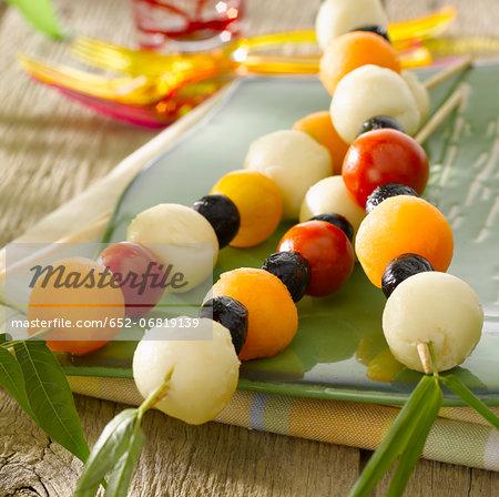 Cherry tomato,olive,melon ball and cheese aperitif brochettes