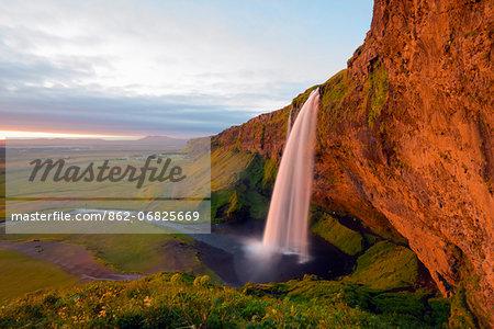 Iceland, southern region, Seljalandsfoss waterfall, sunset