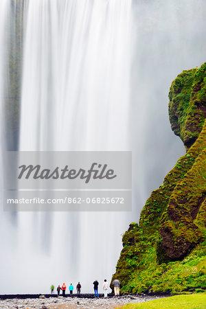 Iceland, southern region, tourists at Skogafoss waterfall