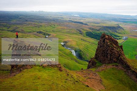 Iceland, southern region, hiker near Skogafoss waterfall (MR)