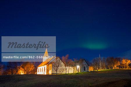Europe, Iceland, Reykjavik, northern lights, aurora borealis above suburban church