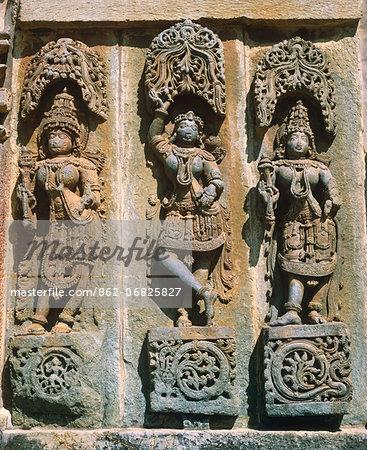 Asia, India, Karnataka.  Belur,  Chennakesava Temple.   Three women in ritual dancing poses.