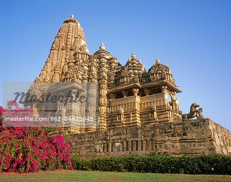 Asia, India, Madhya Pradesh, Khajuraho.  Kandariya Mahadev Temple, western group.  Lion and figure fighting.