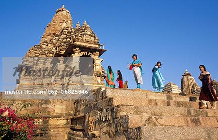Asia, India, Madhya Pradesh, Khajuraho.  Kandariya Mahadev Temple, western group.   Indian tourists enjoy looking around.