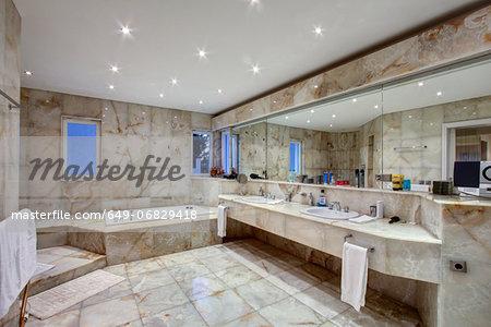 Marble tiled bathroom of luxury villa