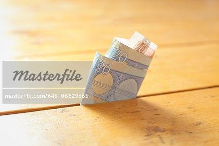 Twenty Euro note in between floorboards