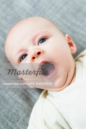 Portrait of baby boy yawning