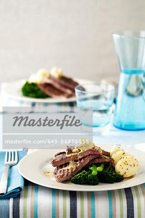 Steak, potatoes, broccoli and dressing