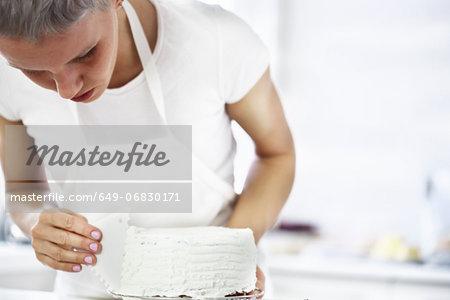 Woman decorating cake