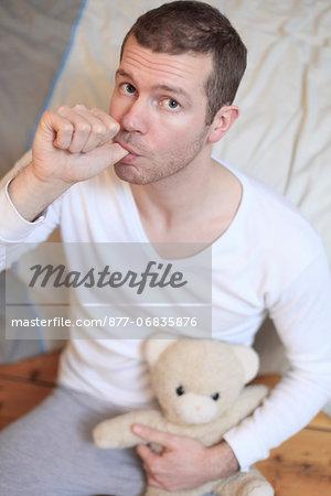 France man at home.Teddy bear.