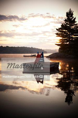 Slide on Floating Dock in Morning, Riley Lake, Muskoka, Northern Ontario, Canada.