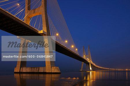 Ponte Vasco da Gama Illuminated at Night across Tagus River, Lisbon, Portugal