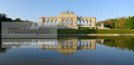 Gloriette reflected in Pond in Garden at Schonbrunn Palace, Vienna, Austria