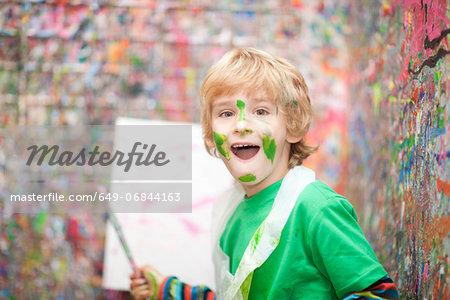 Boy in paint splattered room
