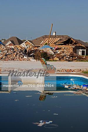 Chair beside Swimming Pool in Neightbourhood Damaged by Tornado, Moore, Oklahoma, USA.