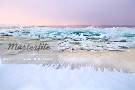 big pieces of broken ice on frozen North sea, Netherlands