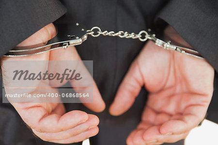 Closeup of handcuffed business criminal