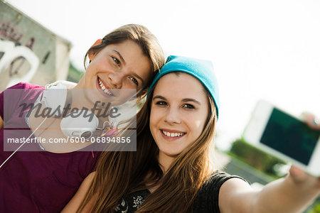 Girls Taking Self Portrait in Skatepark, Feudenheim, Mannheim, Baden-Wurttemberg, Germany