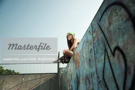 Teenage Girl Hanging out in Skatepark, Feudenheim, Mannheim, Baden-Wurttemberg, Germany