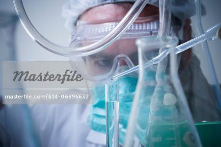Scientist using pipette, close up