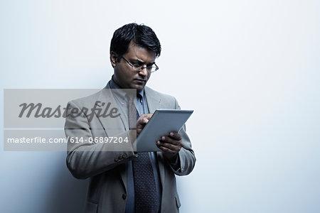 Studio portrait of businessman with digital tablet