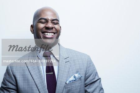 Studio portrait of businessman laughing