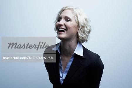 Studio portrait of businesswoman laughing