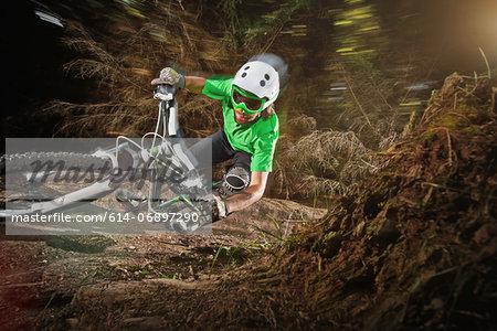 Mountain biker riding narrow track