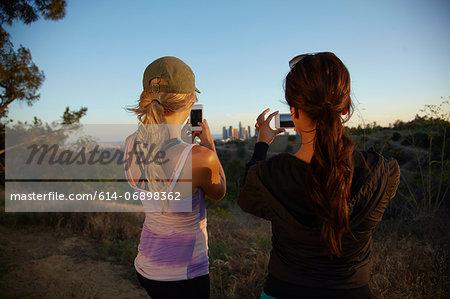 Women photographing scenery