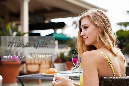 Woman in outdoor café relaxing