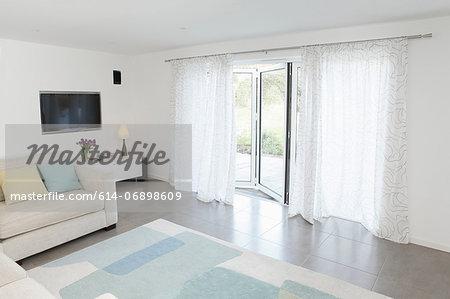 Living room with glass door to garden ajar
