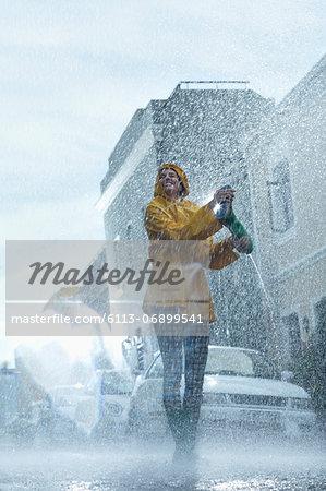 Happy woman walking barefoot in rain