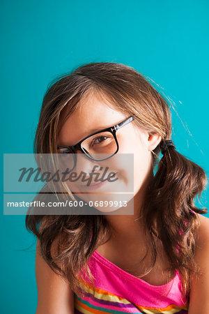 Portrait of girl wearing eyeglasses, smiling at camera, Germany
