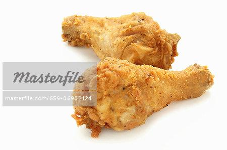 Two deep-fried chicken legs