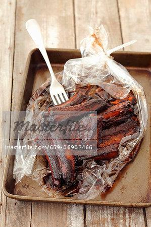 Roasted pork ribs in roasting sleeve