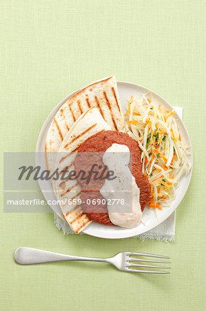 Grilled tortillas with Frikadellen (German meat patties), coleslaw and yoghurt sauce