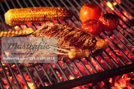 Barbecued T-bone steak with barbecued vegetables
