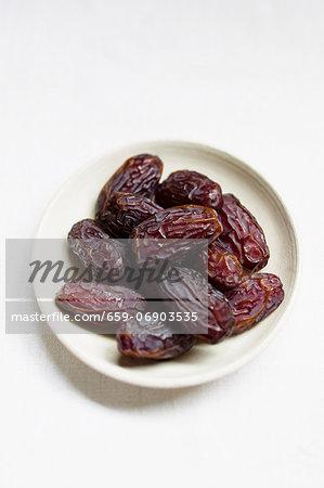 Medjool dates in a small bowl