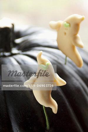 Candy Ghosts in a Black Pumpkin