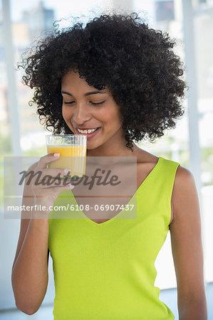 Close-up of a woman drinking mango shake