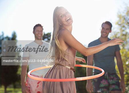 Girl hula hooping outdoors