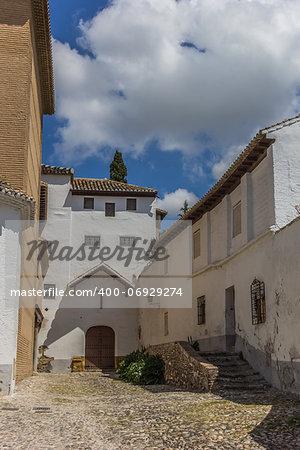 Courtyard and church in moorish Granada quarter Albaicin