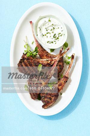 Overhead View of Grilled Lamb Chops with Fresh Herb Yogurt, Studio Shot