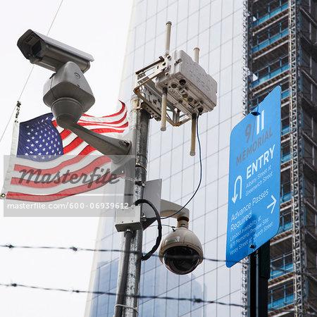Surveillance Cameras and American Flag by One World Trade Center, New York City, New York, USA