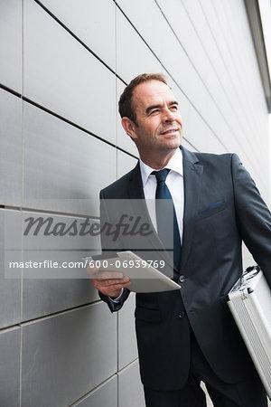 Portrait of Businessman using Tablet Computer, Mannheim, Baden-Wurttemberg, Germany