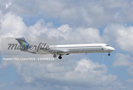 Passenger jet airplane in flight side view