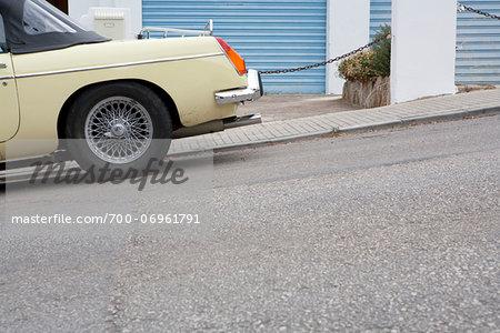 Close-up of car parked on hill on street, Port d'Andratx, Andratx, Majorca, Spain