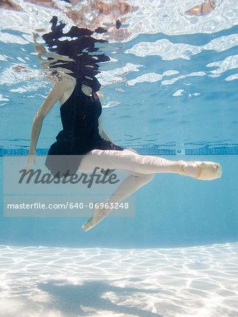 USA, Utah, Orem, Female ballet dancer under water