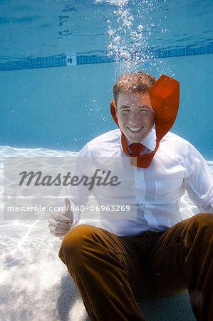 USA, Utah, Orem, Portrait of young groom under water