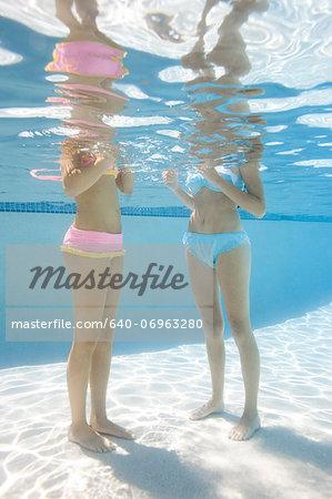 USA, Utah, Orem, Young women standing under water